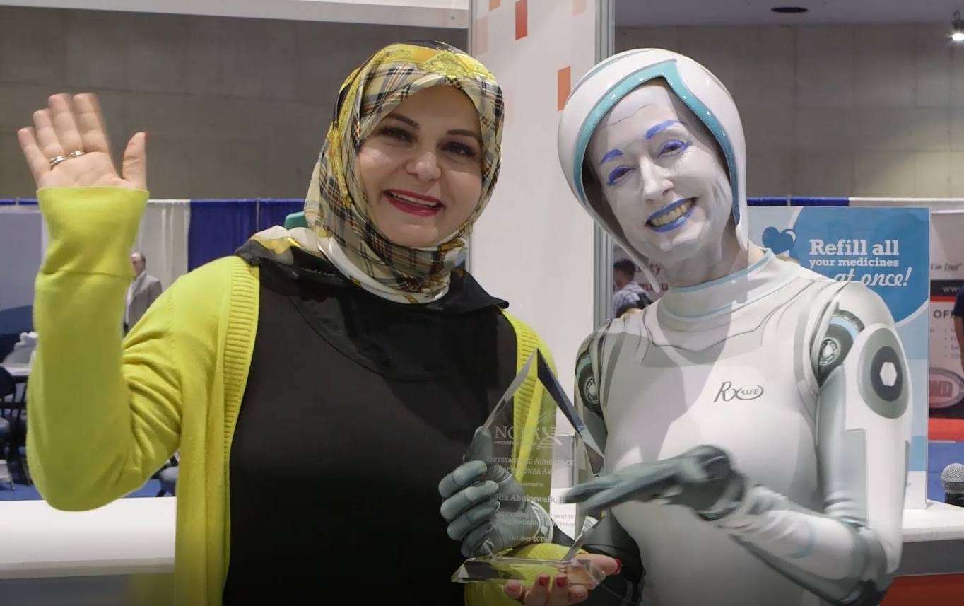 Ghada and Rxy the robot