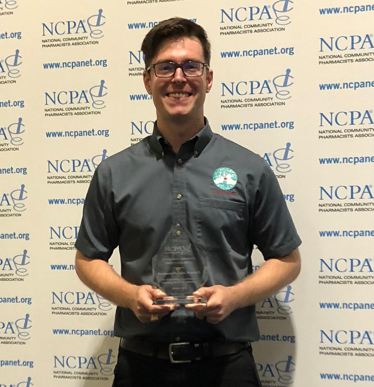 Dr. Benjamin McNabb with the NCPA adherence award