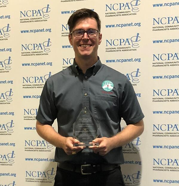 Dr. Benjamin McNabb with the NCPA adherence award